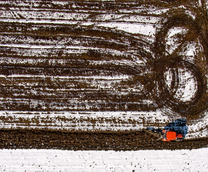 Tractor plowing a field (Sky view)